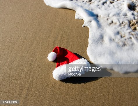 SANTA HAT ON BEACH