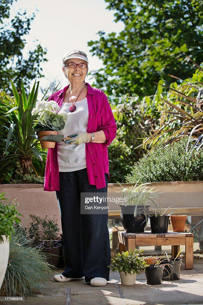 ELDERLY WOMAN GARDENING,READING,SEWING ETC : Stock Photo