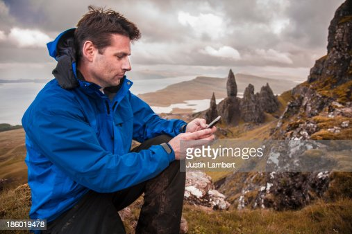 MAN WRITES TEXT MESSAGE AT BEAUTY SPOT IN SCOTLAND