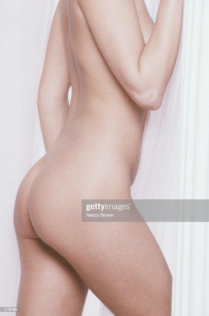 PROFILE OF NUDE FEMALE TORSO : Stock Photo