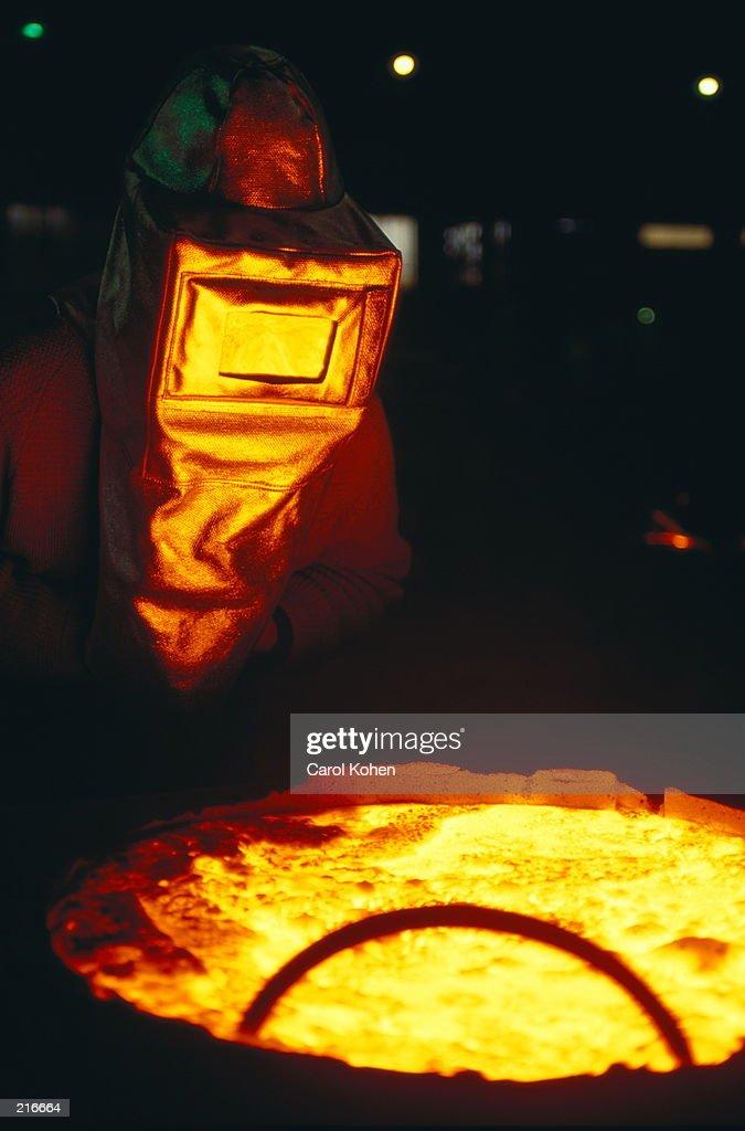 STEELWORKER W/MOLTEN STEEL IN BELGIUM : Stock Photo