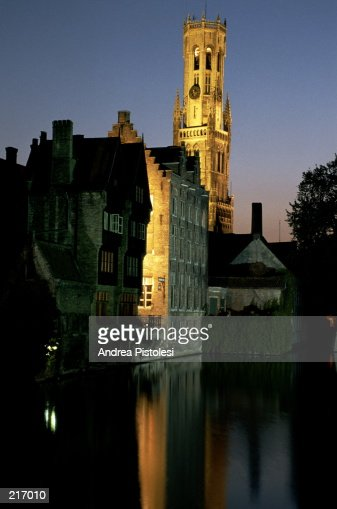 BELL TOWER & BUILDINGS AT DUSK IN BRUGES, BELGIUM : Stock Photo