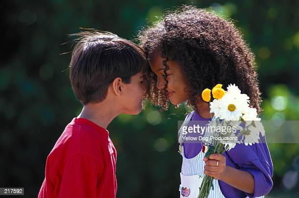 BOY & GIRL WITH FLOWERS FACE TO FACE