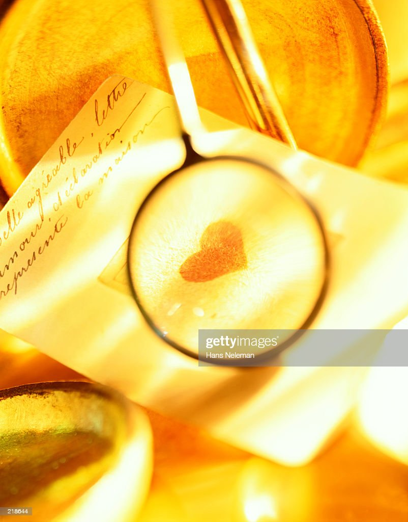 LETTER WITH MAGNIFIED HEART : Stock Photo