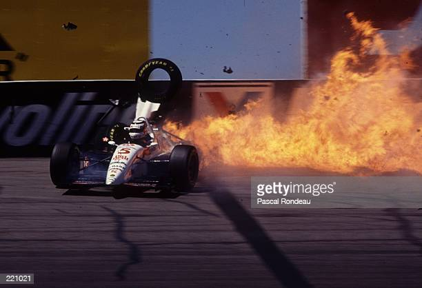 TYRES AND DEBRIS FLY THROUGH THE AIR AND A WALL OF FLAME STRETCHES BEHIND THE CAR AS FORMER FORMULA ONE WORLD CHAMPION NIGEL MANSELL OF GREAT BRITAIN...