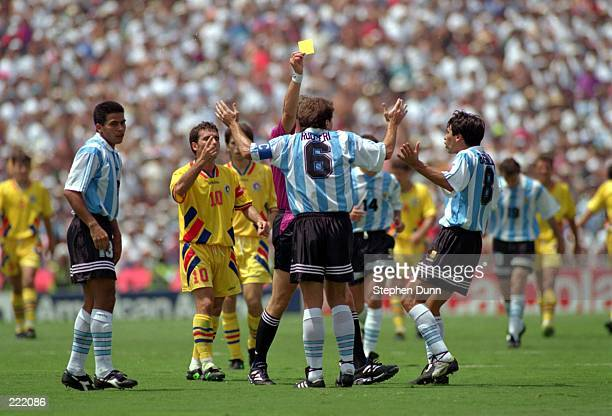 JOSE BASUALDO OF ARGENTINA ID YELLOW CARDED BY THE REFEREE DURING ARGENTINA'S 32 LOSS TO ROMANIA IN A SECOND STAGE 1994 WORLD CUP MATCH AT THE ROSE...