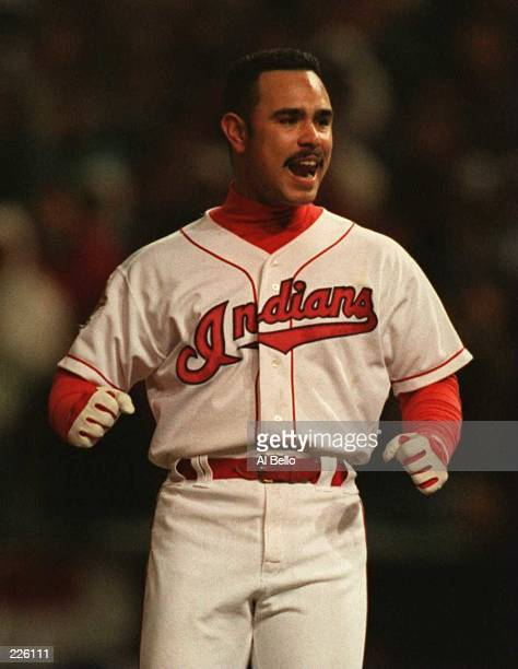 CARLOS BAERGA OF THE CLEVELAND INDIANS CELEBRATES AFTER HITTING A DOUBLE IN THE ELEVENTH INNING TO SET UP THE WINNING RUN OF GAME THREE OF THE 1995...