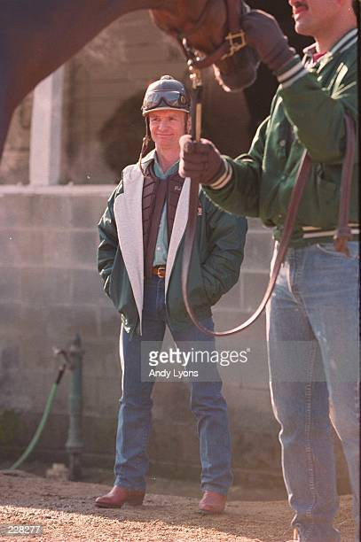 PAT DAY JOCKEY OF TIMBER COUNTRY WATCHES AS THE HORSE IS WASHED OUTSIDE THE BARN OF TRAINER D WAYNE LUKAS ON WEDNESDAY MORNING AT CHURCHILL DOWNS IN...