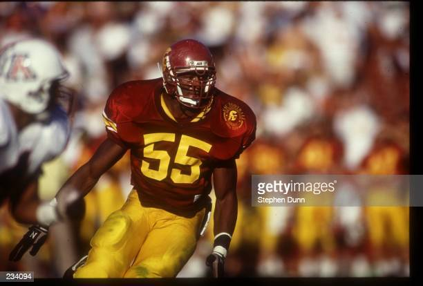 USC LINEBACKER WILLIE MCGINEST RUSHES THE QUARTERBACK DURING THE TROJANS 147 VICTORY OVER THE ARIZONA WILDCATS