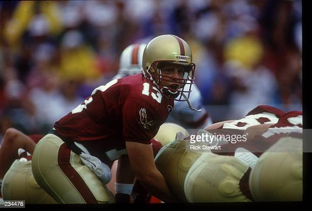 BOSTON COLLEGE QUARTERBACK GLENN FOLEY BARKS OUT SIGNALS FROM UNDER CENTER DURING THE SCREAMING EAGLES 237 LOSS TO THE MIAMI HURRICANES