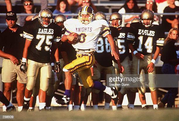 ALLSTATE WIDE RECEIVER JIM ROMERO OF LOS ANGELES BAPTIST HIGH SCHOOL STREAKS DOWN THE SIDELINE FOR A TOUCHDOWN AS THE OAK PARK BENCH LOOKS ON DURING...