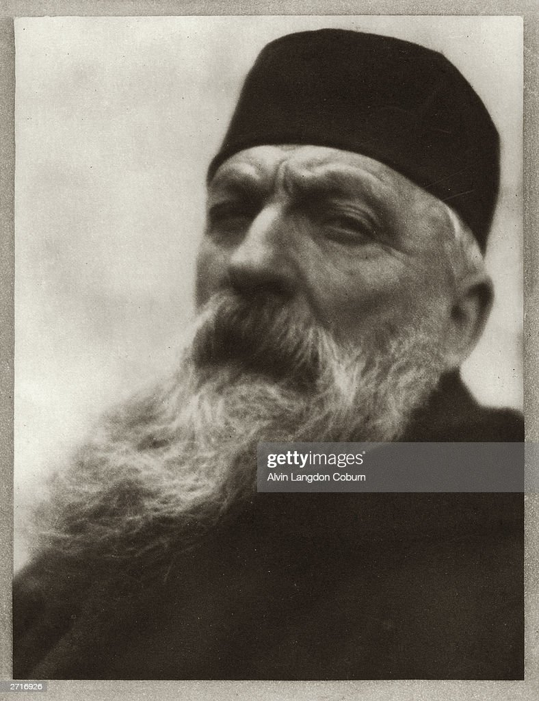 Headshot portrait of French sculptor Auguste Rodin wearing a dark cap and coat Original Artwork Photogravure from 'Men of Mark' published 1913