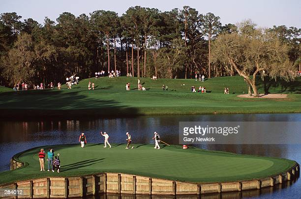 BERNHARD LANGER OF GERMANY ACKNOWLEDGES THE CROWD AFTER FINISHING THE 17TH HOLE AT TPC SAWGRASS IN PONTE VEDRA FLORIDA