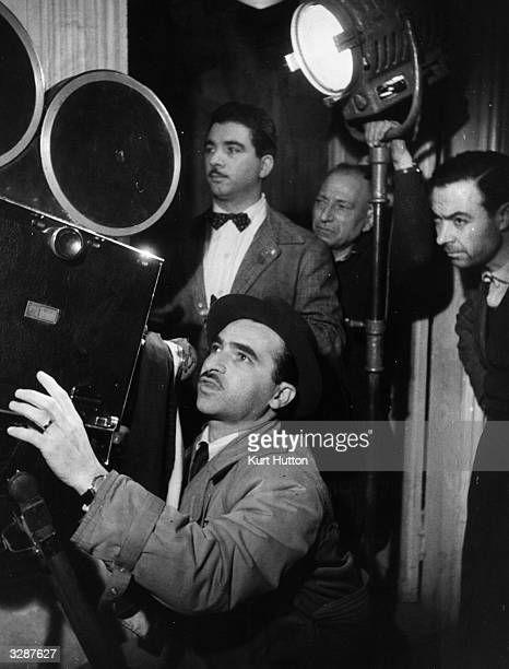 Italian film director Alberto Lattuada behind the camera during the filming of 'Senza Pieta' Original Publication Picture Post 4529 Makers Of The...