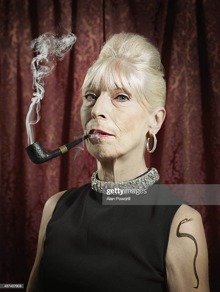 PORTRAIT OF WOMAN SMOKING A PIPE
