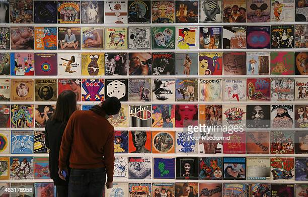 Visitors to the Magnificent Obsessions The Artist as Collector exhibition at the Barbican Art Gallery look at record covers collected by Mexican...