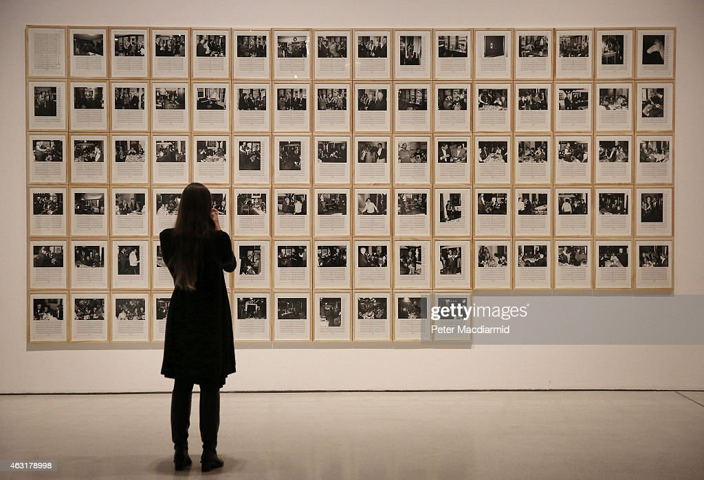 A visitor to the Magnificent Obsessions The Artist as Collector exhibition at the Barbican Art Gallery views Hanne Darboven's artwork on February 11...