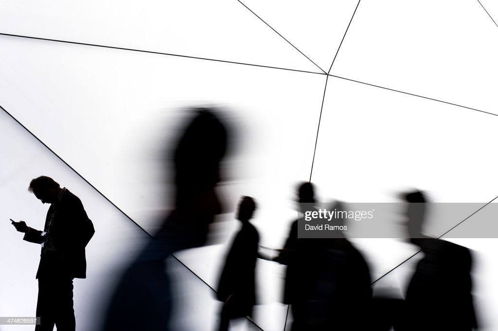 Visitors walk past a Samsung stand during the first day of the Mobile World Congress 2014 at the Fira Gran Via complex on February 24 2014 in...