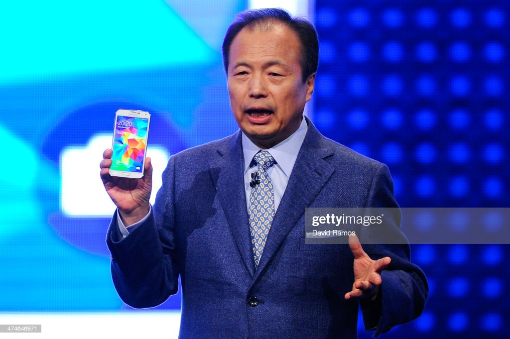 CEO and President of Samsung JK Shin presents new Samsung Galaxy S5 during the first day of the Mobile World Congress 2013 at Forum Complex on...