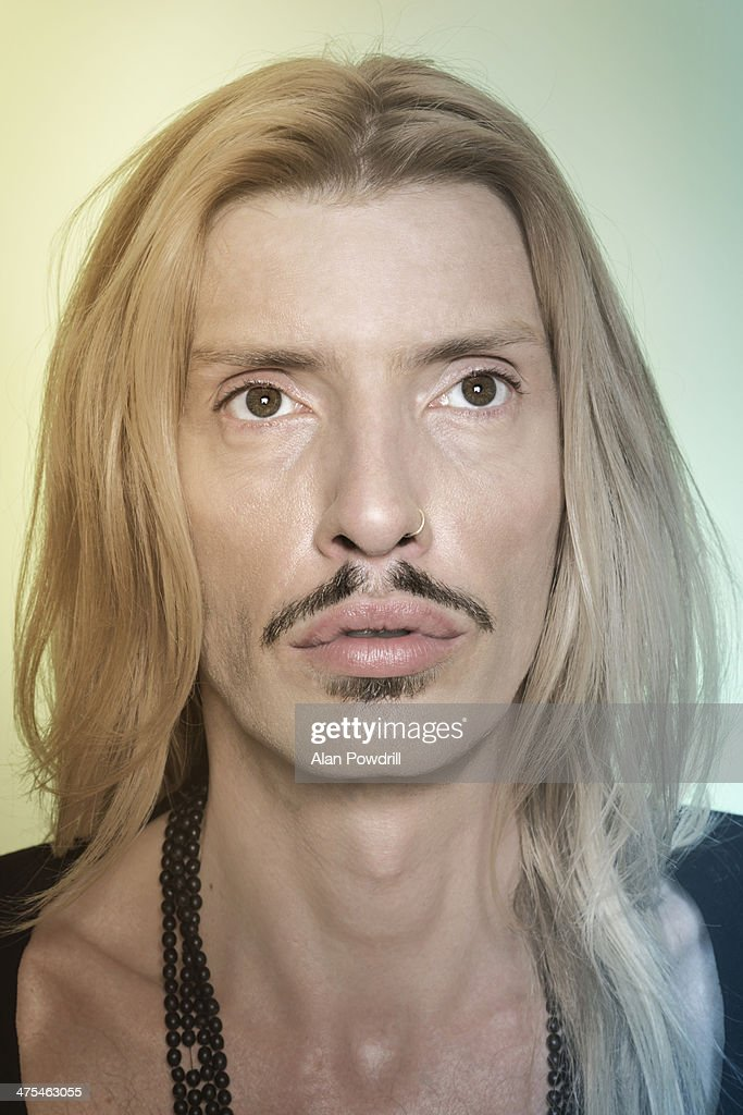 PORTRAIT OF LONG HAIRED MAN : Stock Photo