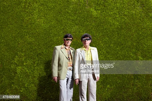 TWO ELDERLY MEN DRESSED IN 70'S OUTFITS : Stock Photo