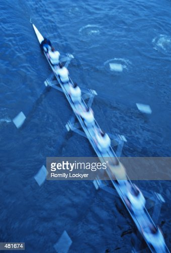 ROWING EIGHT IN ENGLAND IN BLUR MOTION : Stock Photo