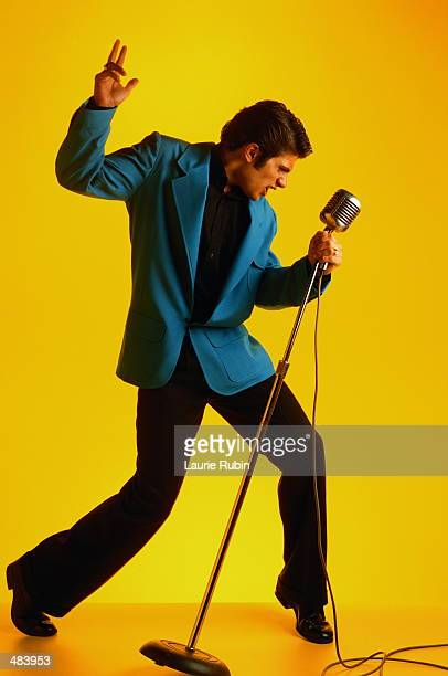 ELVIS IMPERSONATOR IN BLUE JACKET