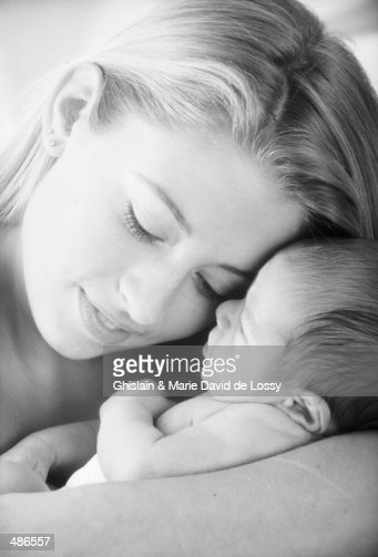 Mother Holding Baby In Black And White Stock Photo | Getty ...