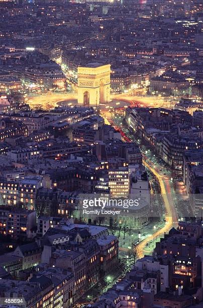 ARC DE TRIOMPHE AT NIGHT & CITY IN PARIS