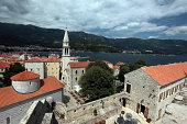 Die Altstadt mit der Kirche Sv. Ivan Krstitelji der Adria Stadt Budva mit vielen neuen Appatementhausern in Montenegro im Balkan am Mittelmeer in Europa.