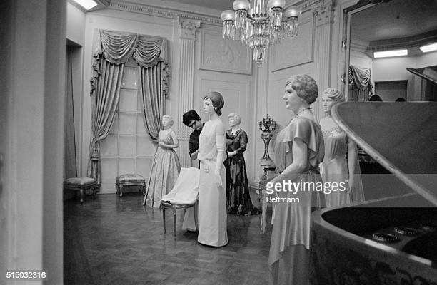 MRS JACQUELINE KENNEDY'S INAUGURAL BALL GOWN WAS FORMALLYPUT ON DISPLAY AT THE SMITHSONIAN INSTITUTION TODAY TO JOIN THOSE OF OTHER FIRST LADIESSUSAN...