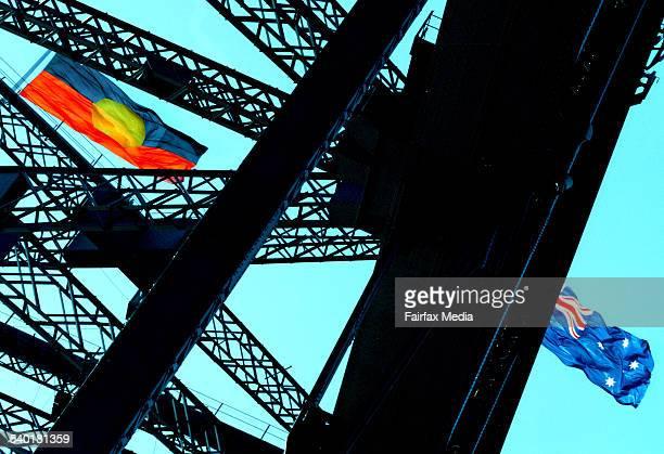 AN ABORIGINAL FLAG AND AUSTRALIAN FLAG FLY ABOVE THE SYDNEY HARBOUR BRIDGE