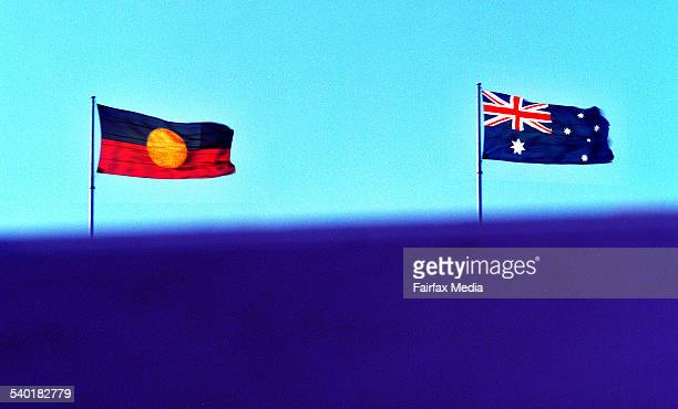 AN ABORIGINAL AND AUSTRALIAN FLAG FLY ON TOP OF THE SYDNEY HARBOUR BRIDGE