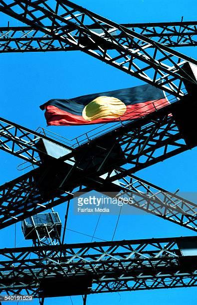 AN ABORIGINAL FLAG FLIES ABOVE THE SYDNEY HARBOUR BRIDGE