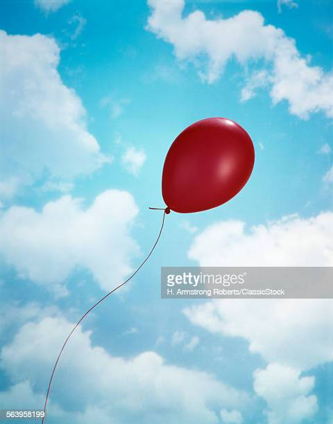 SINGLE RED BALLOON BLUE SKY
