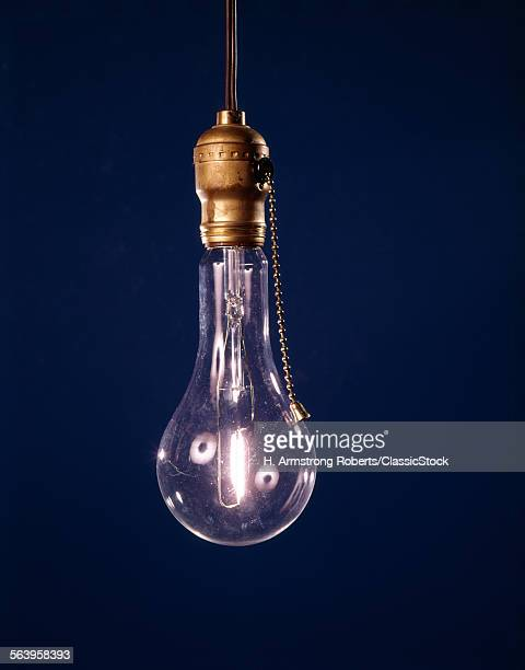 SINGLE BARE LIT LIGHT BULB...
