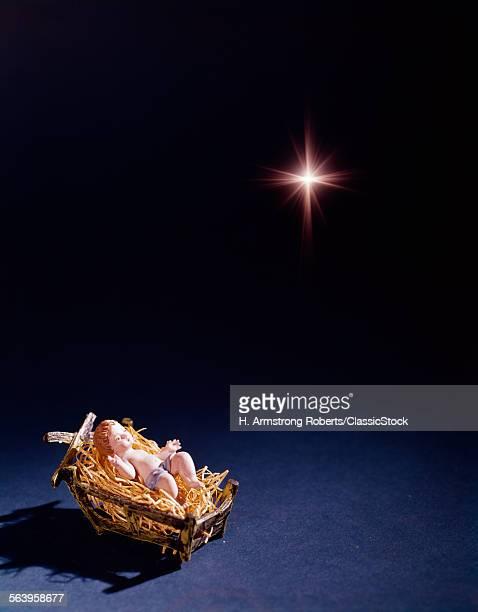 BABY JESUS FIGURINE IN HAY...