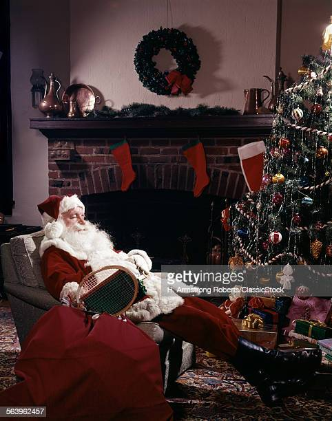 SANTA CLAUS ASLEEP IN...