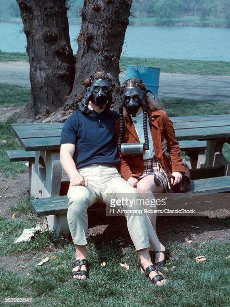 COUPLE SITTING ON PARK...