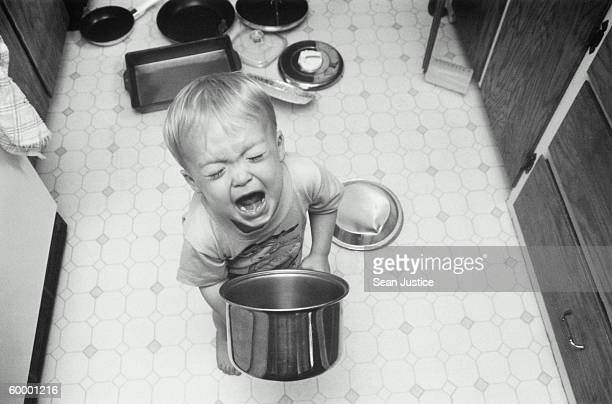 BOY PLAYING WITH POTS AND PANS, SCREAMING