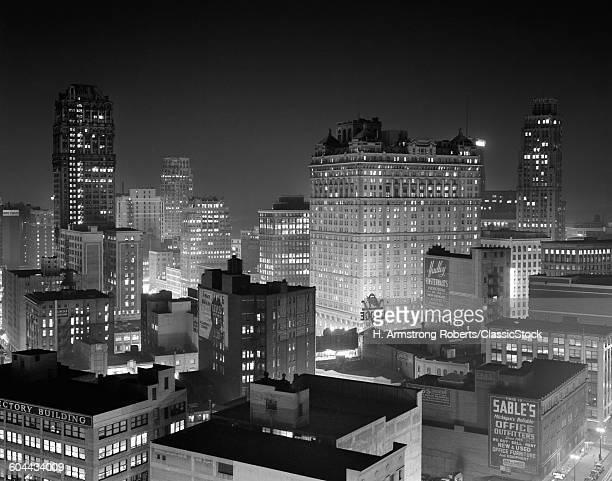 1954 NIGHT SKYLINE RETAIL.