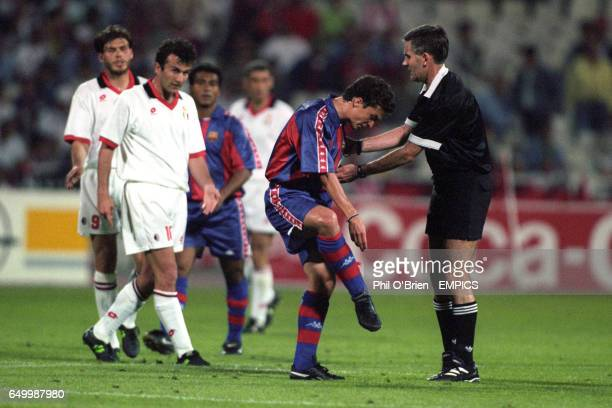 S GUILLERMO AMOR SHOWS HIS TORN SOCK TO REFEREE PHILIP DON