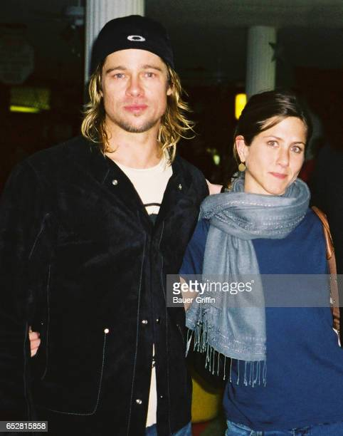 BRAD PITT AND JENNIFER ANISTON GO ROLLERBLADING TOGETHER AFTER POSING FOR A PHOTOGRAPH JENNIFER GRABS THE CAMERA AND TAKES A PICTURE OF BRAD WITH THE...