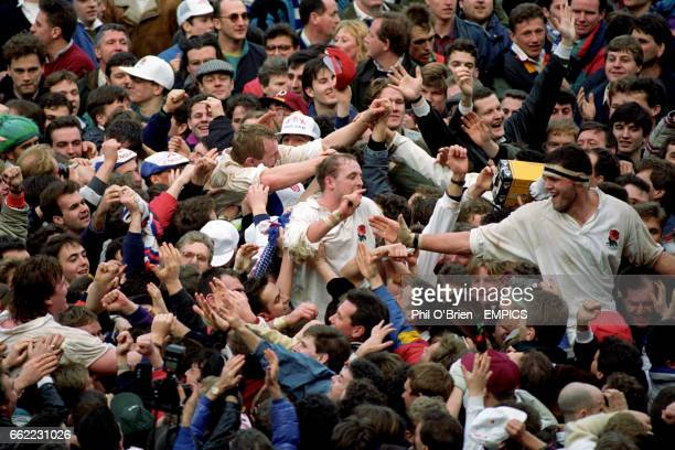 S DEAN RICHARDS DEWI MORRIS AND MARTIN BAYFIELD CARRIED OFF BY FANS AFTER WINNING THE GRAND SLAM