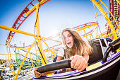 A girl is taking a ride with a rollercoaster at Oktoberfest in Munich / Germany.