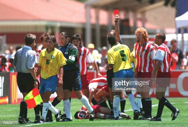 LEONARDO OF BRAZIL ARGUES WITH THE LINESMAN AFTER BEING SENT OFF FOR AN ELBOW TO THE HEAD OF TAB RAMOS OF THE USA DURING THE BRAZIL VERSUS USA MATCH...