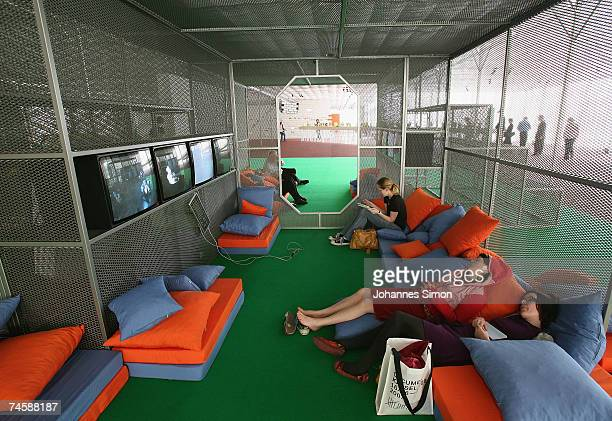 Visitors relax during a media preview of Documenta 12 on June 13 2007 in Kassel Germany The Documenta is 'one of the most important exhibitions of...