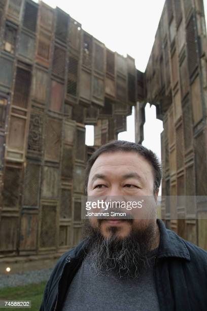 Chinese Artist Ai Weiwei poses in front of his sculpture 'Template' during a media preview of Documenta 12 on June 13 2007 in Kassel Germany The...