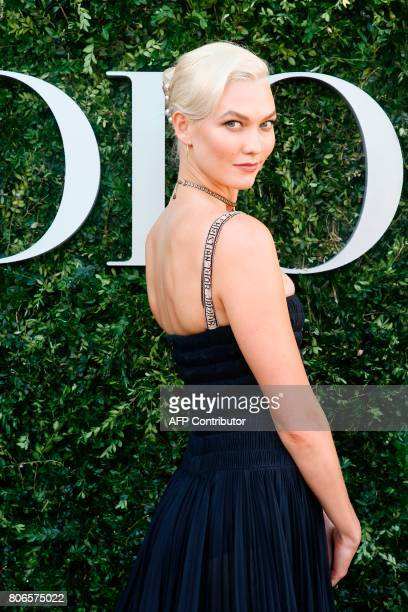 US model and dancer Karlie Kloss poses during the Dior exhibition that celebrates the seventieth anniversary of the Christian Dior fashion house on...