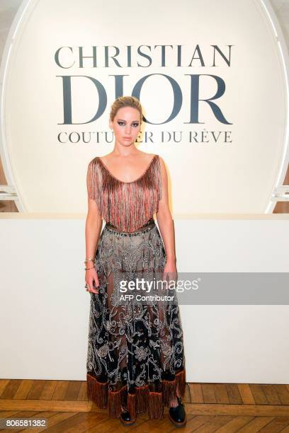US actress Jennifer Lawrence poses as she arrives for the opening of the Dior exhibition that celebrates the seventieth anniversary of the Christian...
